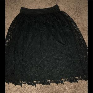 Black, fully lined, crochet lace floral skirt